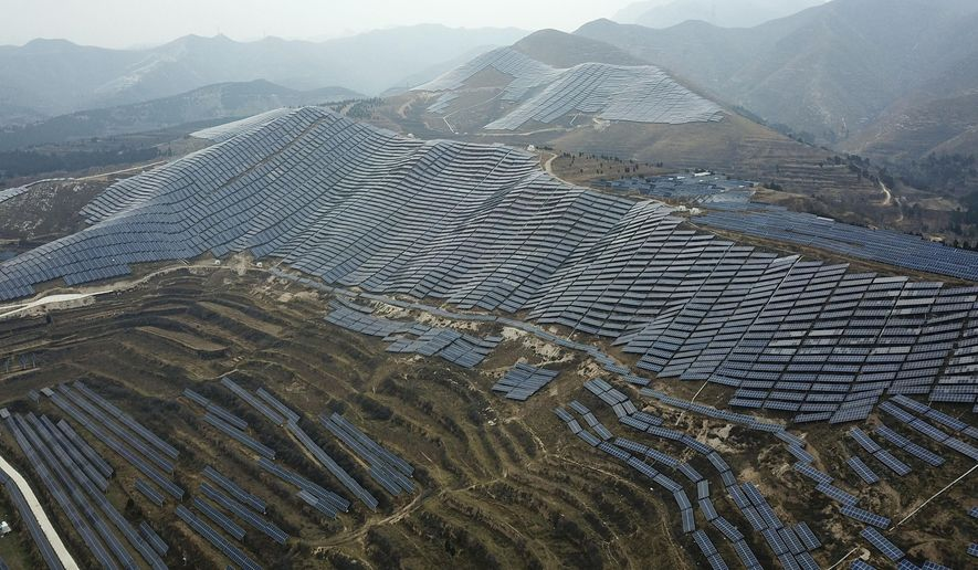 In this Nov. 27, 2019, photo, a solar panel installation is seen in Ruicheng County in central China's Shanxi Province. As world leaders gather in Madrid to discuss how to slow the warming of the planet, a spotlight is falling on China, the top emitter of greenhouse gases. China burns about half the coal used globally each year. Yet it's also the leading market for solar panels, wind turbines and electric vehicles. (AP Photo/Sam McNeil)