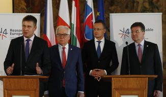 Czech Republic's Foreign Minister Tomas Petricek, left, addresses media together with his counterparts Jacek Czaputowicz of Poland, 2nd left, Miroslav Lajcak of Slovakia, right, and Peter Szijjarto of Hungary, 2nd right, during their joint press in Prague, Czech Republic, Monday, Dec. 2, 2019. (AP Photo/Petr David Josek)