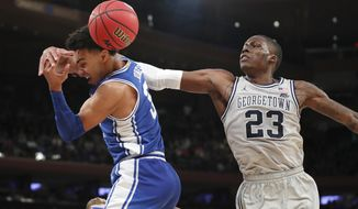 Georgetown forward Josh LeBlanc (23) knocks the ball away from Duke guard Tre Jones (3) during the second half of an NCAA college basketball game in the 2K Empire Classic, Friday, Nov. 22, 2019 in New York. Duke won 81-73. (AP Photo/Kathy Willens) ** FILE **