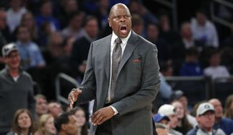 Georgetown coach Patrick Ewing reacts after a series of calls against the team during the second half of an NCAA college basketball game against Duke in the 2K Empire Classic, Friday, Nov. 22, 2019 in New York. Duke won 81-73. (AP Photo/Kathy Willens) ** FILE **
