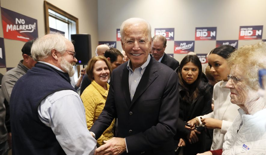 Democratic presidential candidate former Vice President Joe Biden greets audience members during a stop on his bus tour, Monday, Dec. 2, 2019, in Emmetsburg, Iowa. (AP Photo/Charlie Neibergall)