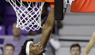Kansas State's Xavier Sneed (20) shoots during the second half of an NCAA college basketball game against Florida A&M, Monday, Dec. 2, 2019, in Manhattan, Kan. AP Photo/Charlie Riedel)