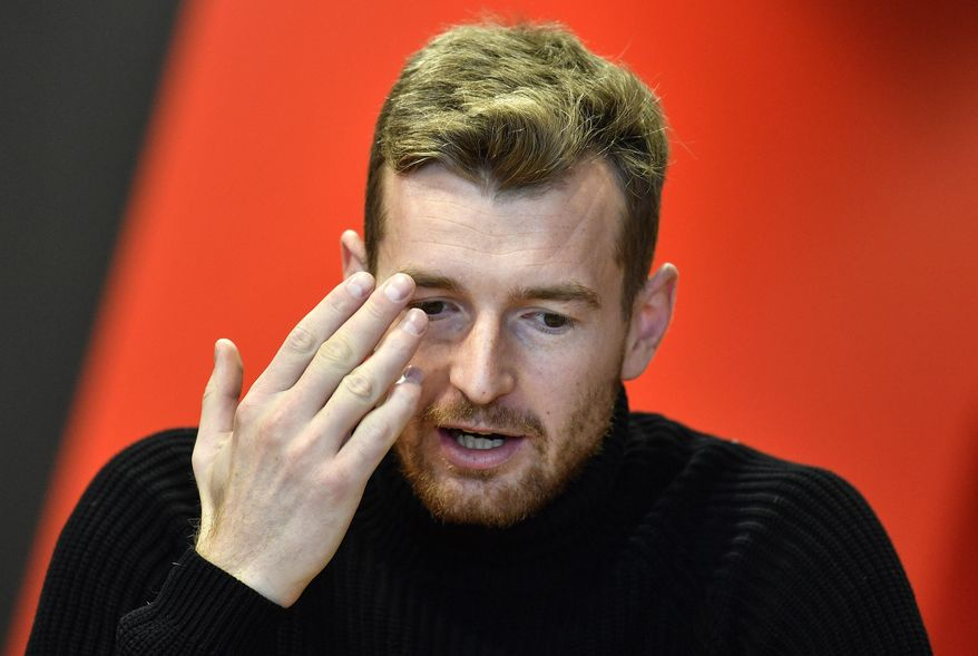 Leverkusen's goalkeeper Lukas Hradecky talks during an interview with the Associated Press at the BayArena in Leverkusen, Germany, Monday, Dec. 2, 2019. Bayer Leverkusen keeper Lukas Hradecky dislodged a contact lens while playing against the German champions Bayern on Saturday, but he still helped Leverkusen to a surprise win. (AP Photo/Martin Meissner)
