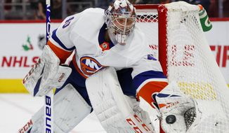 New York Islanders goaltender Semyon Varlamov (40) stops a Detroit Red Wings shot in the second period of an NHL hockey game Monday, Dec. 2, 2019, in Detroit. (AP Photo/Paul Sancya)