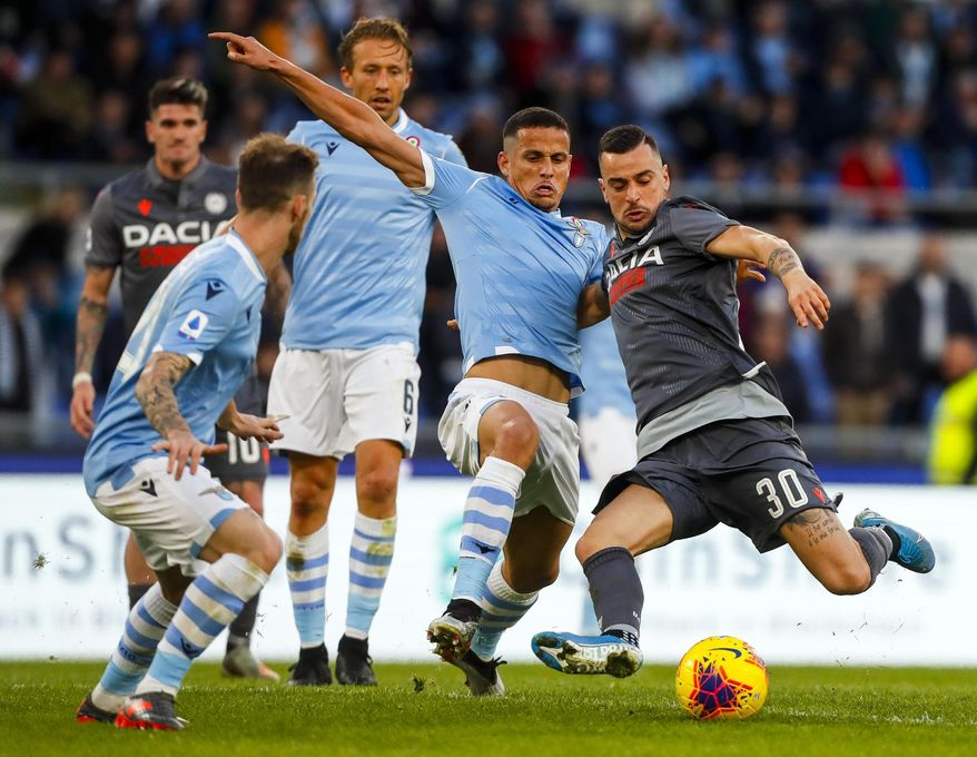 Udinese's Ilija Nestorovski, right, prepares to kick the ball during the Italian Serie A soccer match between Lazio and Udinese at the Olympic stadium in Rome, Sunday, Dec. 1, 2019. (Angelo Carconi/ANSA via AP)