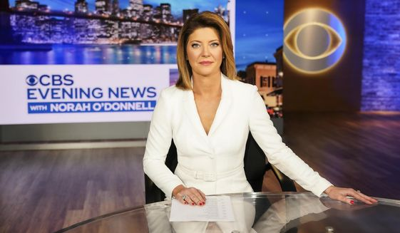 """This image released by CBS shows Norah O'Donnell, host of the new """"CBS Evening News with Norah O'Donnell."""" CBS  will broadcast their evening news show from a new studio in Washington, beginning Monday, Dec. 2. (Michele Crowe/CBS via AP)"""