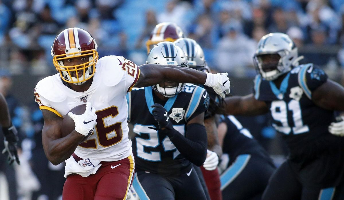 Redskins pick up Peterson's contract