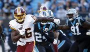 Washington Redskins running back Adrian Peterson (26) runs against the Carolina Panthers during the second half of an NFL football game in Charlotte, N.C., Sunday, Dec. 1, 2019. (AP Photo/Brian Blanco) ** FILE **