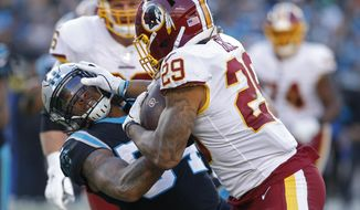 Washington Redskins running back Derrius Guice (29) runs against Carolina Panthers outside linebacker Shaq Thompson (54) during the second half of an NFL football game in Charlotte, N.C., Sunday, Dec. 1, 2019. (AP Photo/Brian Blanco)