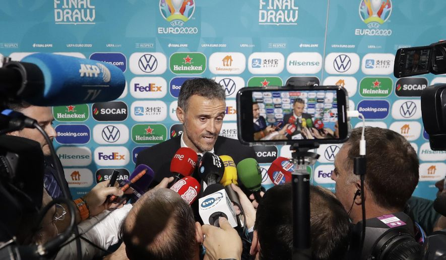 Spain coach Luis Enrique talks to journalists after the draw for the UEFA Euro 2020 soccer tournament finals in Bucharest, Romania, Saturday, Nov. 30, 2019. (AP Photo/Petr David Josek)