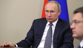 Russian President Vladimir Putin attends a joint video conference with Chinese President Xi Jinping during inaugurating the Power of Siberia pipeline in the Bocharov Ruchei residence in the Black Sea resort of Sochi, Russia, Monday, Dec. 2, 2019. China and Russia launched Monday a more than 6,000 kilometer-long gas pipeline in one realization of the countries' long-planned energy partnerships. (Mikhail Klimentyev, Sputnik, Kremlin Pool Photo via AP)