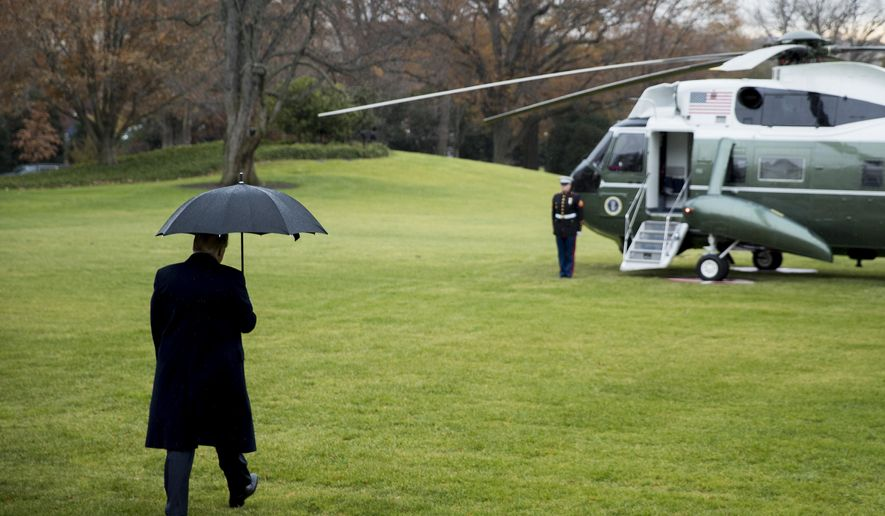 President Donald Trump walks to Marine One on the south Lawn of the White House in Washington, Monday, Dec. 2, 2019, for a short trip to Andrews Air Force Base, Md., and then on to London. (AP Photo/Andrew Harnik)