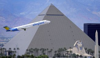 FILE - In this May 9, 2013, file photo, an Allegiant Air jetliner flies by the Luxor Resort & Casino after taking off from McCarran International Airport in Las Vegas. Federal aviation officials are asking southern Nevada residents to weigh in about proposals to redesign takeoff and landing routes in the skies around North Las Vegas, Henderson Executive and McCarran International airports. The Federal Aviation Administration says current routes are safe, but its Metroplex project aims to cut fuel costs for airlines, reduce pollution, improve pilot-and-controller communication and increase efficiency. (AP Photo/David Becker, File)
