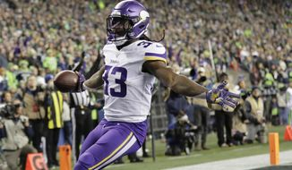 Minnesota Vikings' Dalvin Cook reacts after scoring against the Seattle Seahawks during the first half of an NFL football game, Monday, Dec. 2, 2019, in Seattle. (AP Photo/Ted S. Warren)
