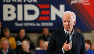 Democratic presidential candidate former Vice President Joe Biden speaks to local residents during a bus tour stop, Tuesday, Dec. 3, 2019, in Mason City, Iowa. (AP Photo/Charlie Neibergall)
