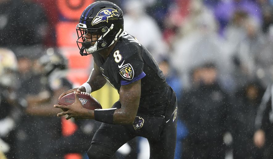 Baltimore Ravens quarterback Lamar Jackson runs the ball against the San Francisco 49ers in the first half of an NFL football game, Sunday, Dec. 1, 2019, in Baltimore, Md. (AP Photo/Gail Burton)