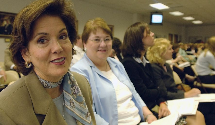 In this file photo from July 2004, Dianne Hensley, left, from Waco, with the McLennan County Collaborative Abstinence Project, sits in the audience and waits her turn to speak to members of the State Board of Education in Austin, Texas. Ms. Hensley, who has gone on to be a justice of the peace, is under fire for her personal policy of declining to officiate same-sex civil marriage ceremonies. Judge Hensley cites her religious beliefs, and says she always refers interested parties to other individuals who are capable of and willing to officiate the ceremony. (AP Photo/Harry Cabluck)