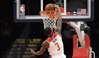 Washington Wizards guard Bradley Beal (3) goes to the basket during the first half of an NBA basketball game against the Orlando Magic, Tuesday, Dec. 3, 2019, in Washington. (AP Photo/Nick Wass)