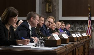 Government Accountability Office, defense capabilities and management director Elizabeth Field, left, Army Secretary Ryan McCarthy, Army Chief of Staff Gen. James McConville, Acting Navy Secretary Thomas Modly, Chief of Naval Operations Adm. Michael Gilday, Marine Corps Commandant Gen. David Berger, Air Force Secretary Barbara Barrett, and Air Force Chief of Staff David Goldfein testify during a hearing of the Senate Armed Services Committee about about ongoing reports of substandard housing conditions Tuesday, Dec. 3, 2019 in Washington, on Capitol Hill. (AP Photo/Alex Brandon)