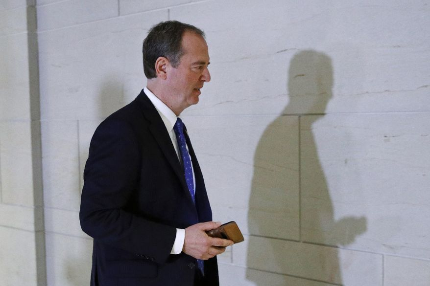 Rep. Adam Schiff, D-Calif., Chairman of the House Intelligence Committee, departs a secure area of the Capitol in Washington, Tuesday, Dec. 3, 2019. The Democrats on the House Intelligence Committee have released a sweeping impeachment report outlining evidence of what it calls President Donald Trump's wrongdoing toward Ukraine. (AP Photo/Patrick Semansky)