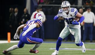Buffalo Bills cornerback Taron Johnson (24) defends asDallas Cowboys tight end Jason Witten (82) looks for running room after catching a pass in the first half of an NFL football game in Arlington, Texas, Thursday, Nov. 28, 2019. (AP Photo/Ron Jenkins)