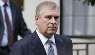 In this Wednesday, June 6, 2012, file photo, Britain's Prince Andrew leaves King Edward VII hospital in London after visiting his father Prince Philip. (AP Photo/Sang Tan, file)