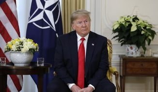 U.S. President Donald Trump meets NATO Secretary General, Jens Stoltenberg at Winfield House in London, Tuesday, Dec. 3, 2019. US President Donald Trump will join other NATO heads of state at Buckingham Palace in London on Tuesday to mark the NATO Alliance's 70th birthday. (AP Photo/Evan Vucci)