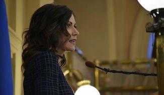 Gov. Kristi Noem announces her 2021 budget to legislators at the Capitol, Tuesday, Dec. 3, 2019, in Pierre, S.D. (Lisa Kaczke/The Argus Leader via AP)