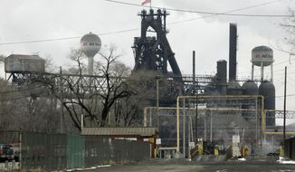 FILE - This Jan. 26, 2009, file photo shows an AK Steel Holding Corp. plant in Middletown, Ohio. Cleveland-Cliffs is buying AK Steel in a stock deal valued at about $1.1 billion. (AP Photo/Al Behrman, File)