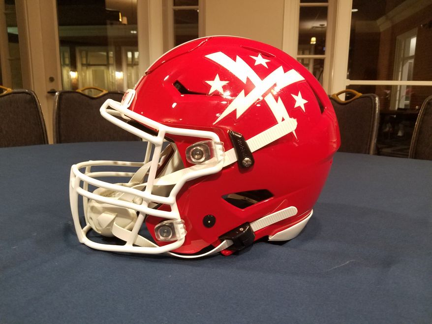 """The DC Defenders of the XFL unveiled their home and away uniforms, including a red helmet with their """"lightning stripes and stars logo"""" in white, on Tuesday, Dec. 3, 2019. (Photo by Adam Zielonka / The Washington Times)"""