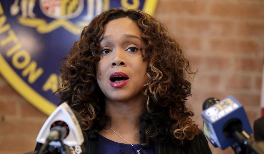 Maryland State Attorney Marilyn Mosby speaks during a news conference announcing the indictment of correctional officers, Tuesday, Dec. 3, 2019, in Baltimore. (AP Photo/Julio Cortez) ** FILE **