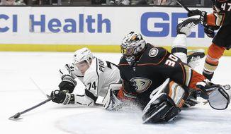 Los Angeles Kings' Nikolai Prokhorkin (74) tries to get the puck around Anaheim Ducks goaltender Ryan Miller (30) during the first period of an NHL hockey game Monday, Dec. 2, 2019, in Anaheim, Calif. (AP Photo/Marcio Jose Sanchez)