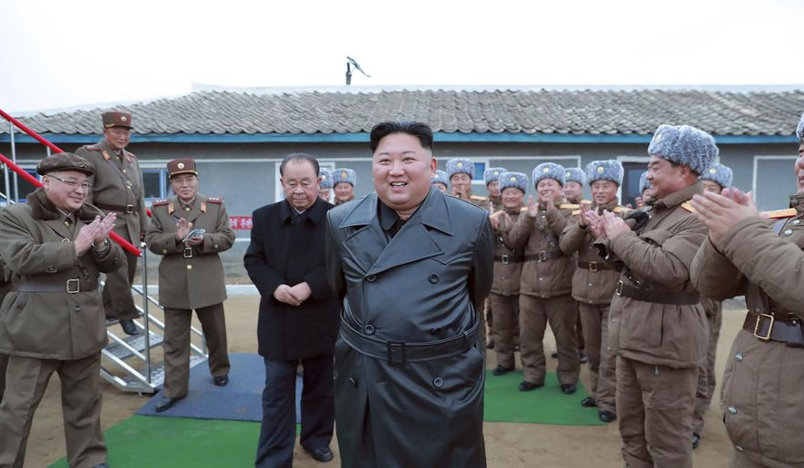 "This undated file photo provided on Friday, Nov. 29, 2019, by the North Korean government, shows North Korean leader Kim Jong-un, center, surrounded by a military unit, reacts to what it claims as a test firing of its ""super-large"" multiple rocket launcher in North Korea. North Korea on Tuesday, Dec. 3, has repeated claims that the Trump administration is running out of time to salvage nuclear negotiations and says it's entirely up to the United States to choose what ""Christmas gift"" it gets from the North. (Korean Central News Agency/Korea News Service via AP, File)"