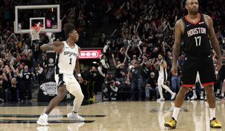 San Antonio Spurs guard Lonnie Walker IV (1) reacts after scoring to tie the score in the final seconds of the second half of an NBA basketball game against the Houston Rockets in San Antonio, Tuesday, Dec. 3, 2019. San Antonio won 135-133 in double overtime. (AP Photo/Eric Gay)