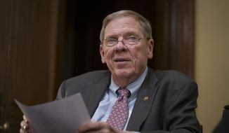 Sen. Johnny Isakson, R-Ga., meets with his staff in his office on Capitol Hill in Washington, Monday, Dec. 2, 2019. Isakson, a three-term senator, announced last summer that he would resign from the Senate on Dec. 31 for health reasons. (AP Photo/J. Scott Applewhite)
