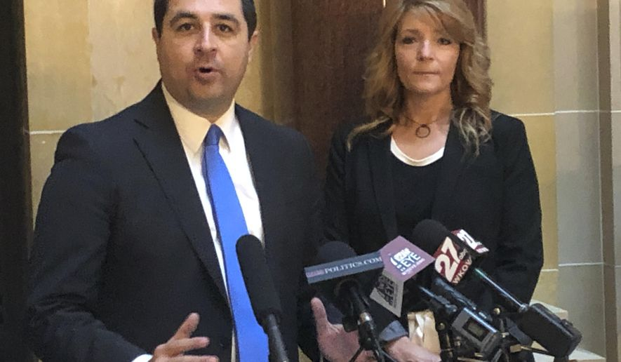 Wisconsin Attorney General Josh Kaul, left, and rape survivor Jacqueline Jaske, call on Republicans to pass a bill designed to prevent the backlog of kits containing evidence from sexual assaults at a Capitol news conference on Tuesday, Dec. 23, 2019, in Madison, Wis. The Senate passed the bill in October, but it's gone nowhere in the Assembly. (AP Photo/Scott Bauer)