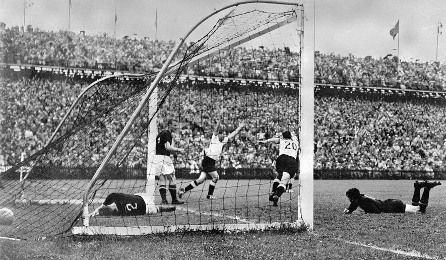 FILE - In this July 4, 1954 file photo, West Germany's Helmut Rahn, center with arms raised, celebrates after equalising in the World Cup soccer final match against Hungary, at Wankdorf Stadium, in Bern, Switzerland. The stadium in Switzerland that staged the 1954 World Cup final is getting its original name back. Swiss champion Young Boys says a new sponsorship deal sees the historic Wankdorf Stadium name restored. It was rebranded Stade de Suisse after being rebuilt for Euro 2008. (AP Photo, File)