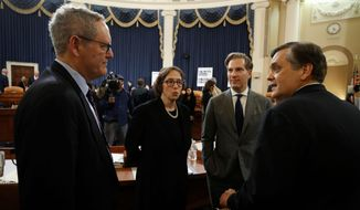 From left, University of North Carolina Law School professor Michael Gerhardt, Stanford Law School professor Pamela Karlan, Harvard Law School professor Noah Feldman and George Washington University Law School professor Jonathan Turley, offered statements at the House impeachment hearings on Wednesday. Mr. Turley, the sole Republican witness, said the president's actions didn't merit impeachment. The others said that they did. (Associated Press)