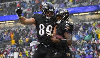 Baltimore Ravens quarterback Lamar Jackson (8) celebrating his touchdown with teammate tight end Mark Andrews (89) in the first half of an NFL football game, Sunday, Dec. 1, 2019, in Baltimore, Md. (AP Photo/Nick Wass)