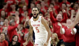 Maryland guard Eric Ayala reacts after dunking on Notre Dame during the first half of an NCAA college basketball game, Wednesday, Dec. 4, 2019, in College Park, Md. (AP Photo/Julio Cortez)
