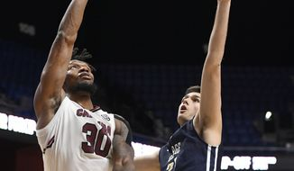 South Carolina's Chris Silva (30) shoots over George Washington's Javier Langarica (32) during the second half of an NCAA college basketball game Sunday, Nov. 18, 2018, in Uncasville, Conn. (AP Photo/Jessica Hill)  **FILE**