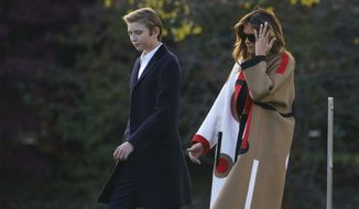 First lady Melania Trump and her son Barron Trump, walk to board Marine One at the White House in Washington, Tuesday, Nov. 20, 2018, for the short trip to Andrews Air Force Base en route to Palm Beach International Airport, in West Palm Beach, Fla., and onto Mar-a-Lago. (AP Photo/Carolyn Kaster) ** FILE **