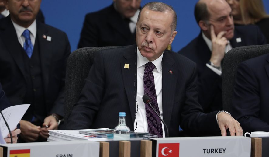 Turkish President Recep Tayyip Erdogan participates in a round table meeting during a NATO leaders meeting at The Grove hotel and resort in Watford, Hertfordshire, England, Wednesday, Dec. 4, 2019. As NATO leaders meet and show that the world's biggest security alliance is adapting to modern threats, NATO Secretary-General Jens Stoltenberg is refusing to concede that the future of the 29-member alliance is under a cloud. (AP Photo/Evan Vucci)