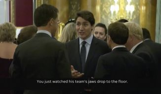 In this grab taken from video on Tuesday, Dec. 3, 2019, Canada's Prime Minister Justin Trudeau, centre, gestures as he speaks during a NATO reception. While NATO leaders are professing unity as they gather for a summit near London, several seem to have been caught in an unguarded exchange on camera apparently gossiping about U.S. President Donald Trumps behavior. In footage recorded during a reception at Buckingham Palace on Tuesday, Canadian Prime Minister Justin Trudeau was seen standing in a huddle with French President Emmanuel Macron, British Prime Minister Boris Johnson, Dutch Prime Minister Mark Rutte and Britains Princess Anne. (Host Broadcaster via AP)