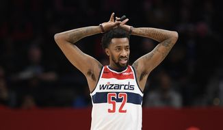Washington Wizards guard Jordan McRae (52) stands on the court during the second half of an NBA basketball game against the Orlando Magic, Tuesday, Dec. 3, 2019, in Washington. The Magic won 127-120. (AP Photo/Nick Wass) ** FILE **