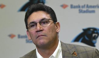 Former Carolina Panthers NFL football head coach Ron Rivera ponders a question during a press conference at Bank of America Stadium in Charlotte, N.C., Wednesday, Dec. 4, 2019. Rivera was fired as coach on Tuesday. (David T. Foster III/The Charlotte Observer via AP)