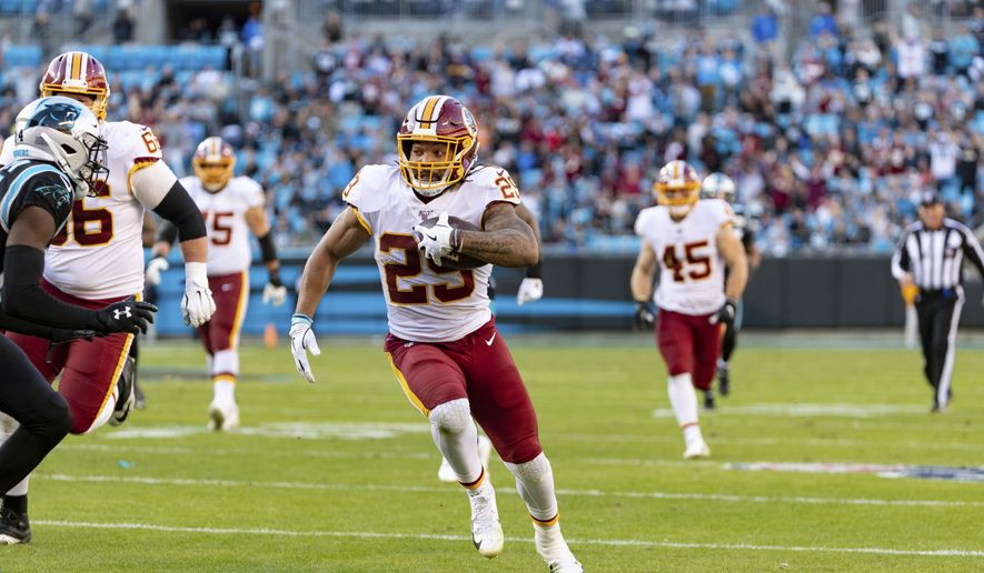 Washington Redskins running back Derrius Guice (29) in action against the Carolina Panthers during an NFL game at Bank of America Stadium in Charlotte, N.C. on Sunday, Dec. 1, 2019. (Chris Keane/AP Images for Panini) ** FILE **