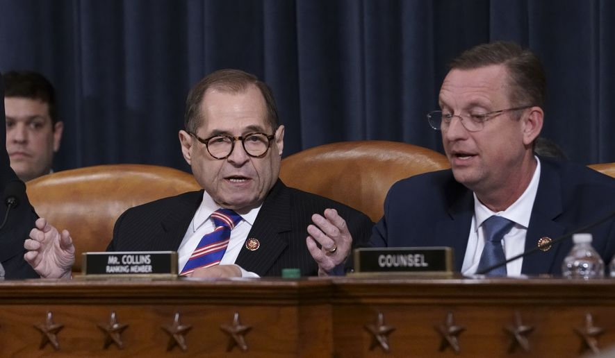 House Judiciary Committee Chairman Jerrold Nadler, D-N.Y., left, talks with Rep. Doug Collins, R-Ga., the ranking member, at the close of a hearing on the constitutional grounds for the impeachment of President Donald Trump, on Capitol Hill in Washington, Wednesday, Dec. 4, 2019. (AP Photo/J. Scott Applewhite)