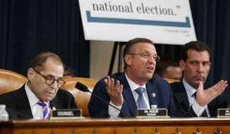 House Judiciary Committee Chairman Rep. Jerrold Nadler, D-N.Y., left, listens as ranking member Rep. Doug Collins, R-Ga., gives his closing statement during the House Judiciary Committee hearing on the constitutional grounds for the impeachment of President Donald Trump, on Capitol Hill in Washington, Wednesday, Dec. 4, 2019 (AP Photo/Alex Brandon)