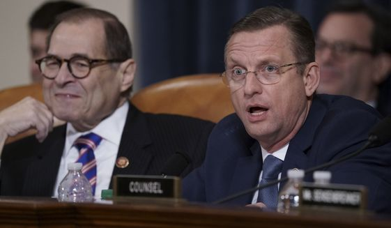Rep. Doug Collins, R-Ga., the ranking member of the House Judiciary Committee, joined at left by Chairman Jerrold Nadler, D-N.Y., makes remarks during a hearing on the constitutional grounds for the impeachment of President Donald Trump, on Capitol Hill in Washington, Wednesday, Dec. 4, 2019. (AP Photo/J. Scott Applewhite)
